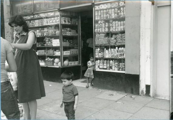 People shopping on Burdett Road in 1983.