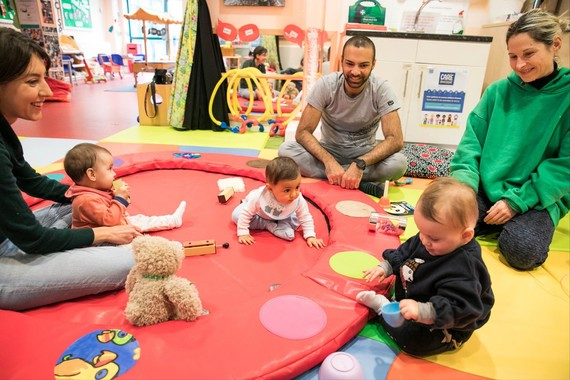 Parents and babies in play centre