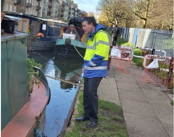 Council worker speaking to a canal boat owner
