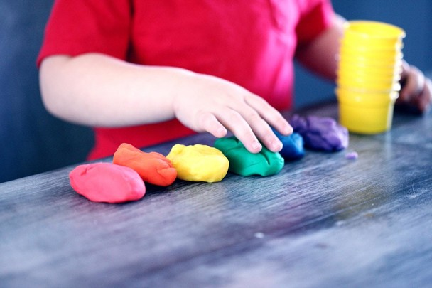 Child playing with colourful clay