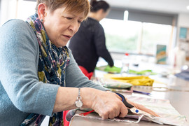 Woman learning to sew - Waltham Forest Adult Learning service
