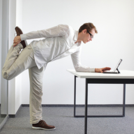 Man exercising at desk