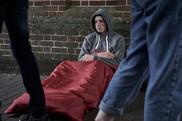 homeless man sleeping bag