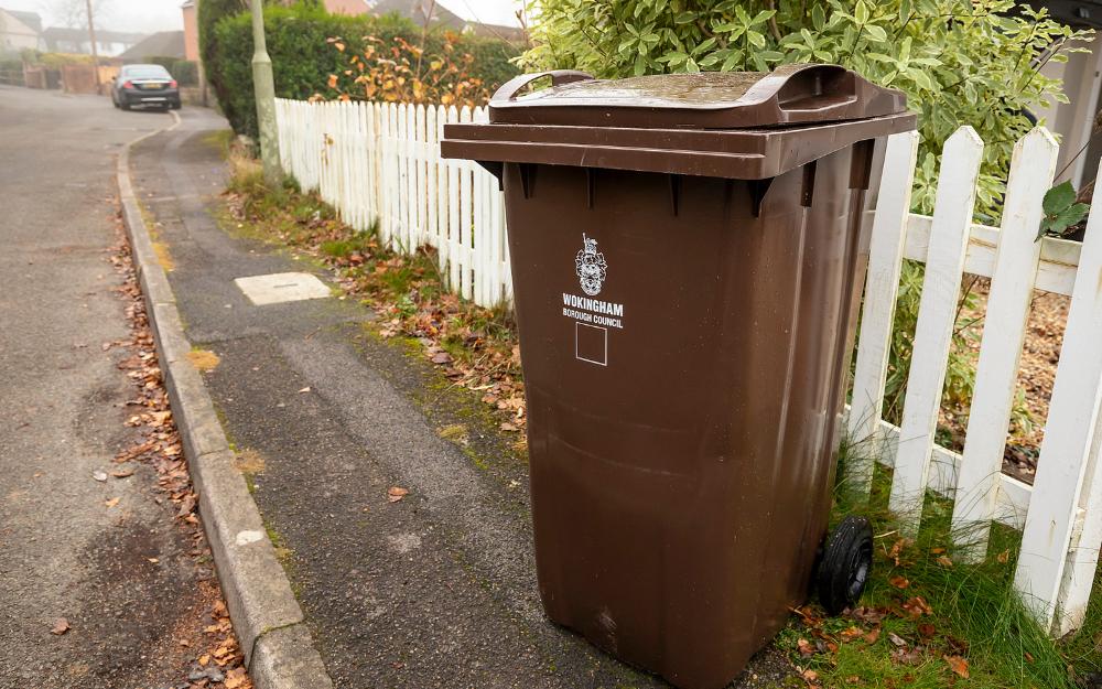 A brown garden waste bin