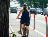 woman cycling down the road