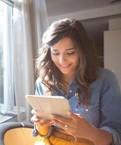 Girl reading tablet