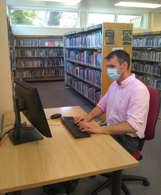 Computer user with mask
