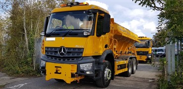 gritter driving out of depot