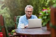 older man on laptop