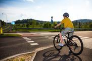 Boy on bike in helmet