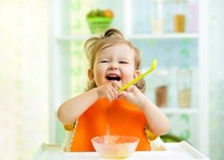 Toddler eating food