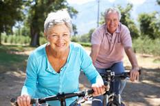 Older people riding bikes