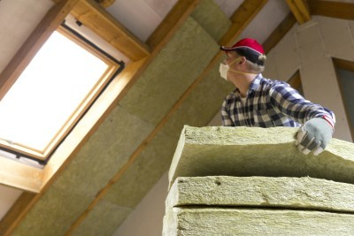 Man installing lot insulation