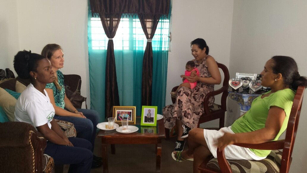 USAID staff meets with family fighting Zika
