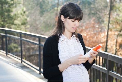 pregnant woman holding insect repellant