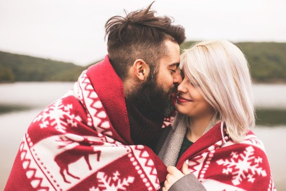 couple hugging in a holiday blanket