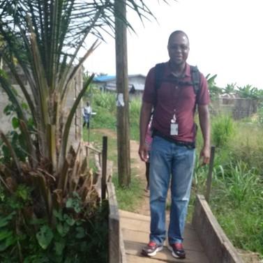 Peter Paye crossing a small bridge