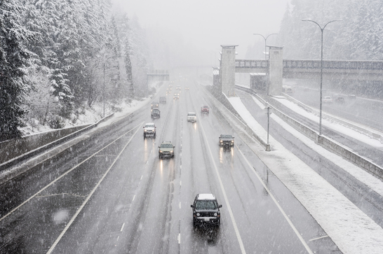 Cars driving on highway in the snow