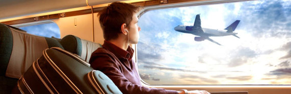 photo of a man traveling on a plane