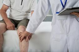Doctor examining patient's leg