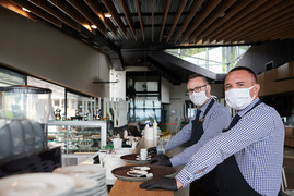 Two restaurant workers wearing masks