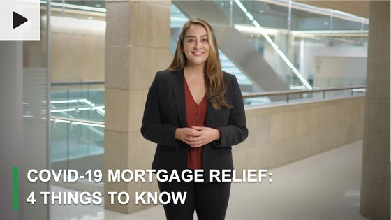 "Woman standing in lobby with text ""COVID-19 Mortgage Relief: 4 Things to Know"""