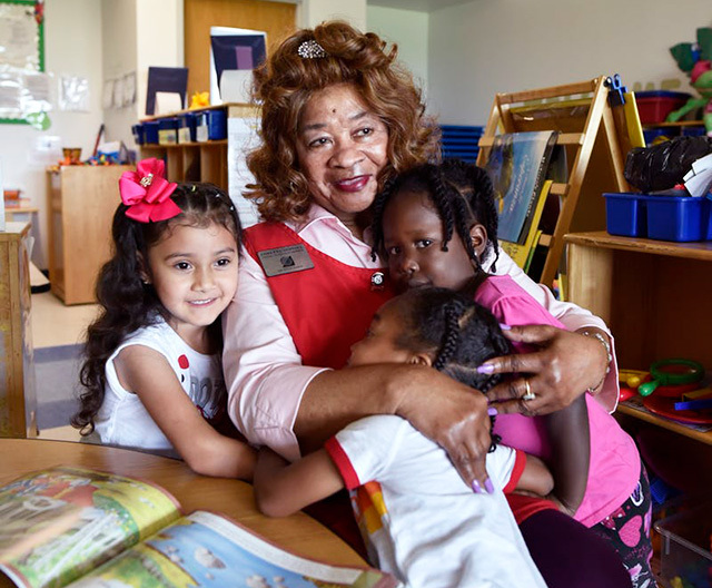 Senior Corps Foster Grandparent Loretta Stovall, 84, gets goodbye hugs at the end of her day at a Head Start center in Dallas.  (Photo by Ben Torres)