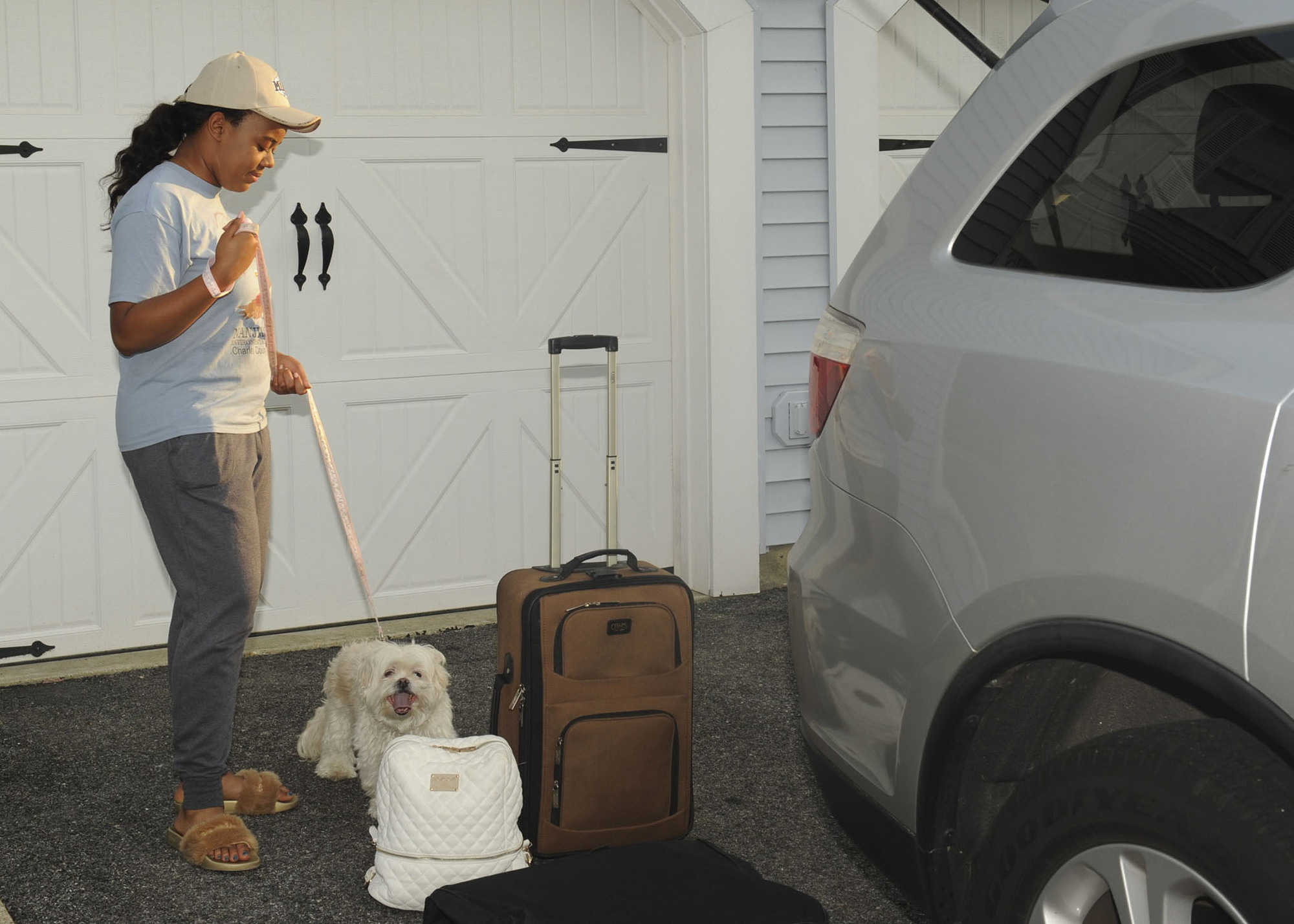 woman with luggage and a dog