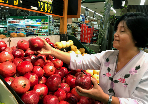 Rebeca Gonzalez says she can now afford to buy pomegranates for her family in Garden Grove, Calif.,