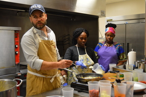 Chef Cory Bahr shares cooking tips with 4-H members Renata Jones, and Averi Austin. Photo by Karol Osborne/LSUAgCenter