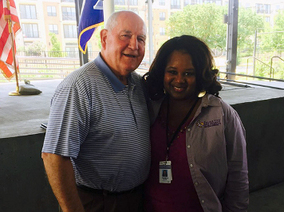 Angela Moore, Agriculture and Natural Resources Extension Associate, with the U.S. Secretary of Agriculture, Sonny Perdue