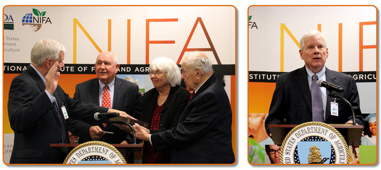 U.S. Agriculture Secretary Sonny Perdue swears in Dr. Scott Angle as the new Director of NIFA as his parents look on.
