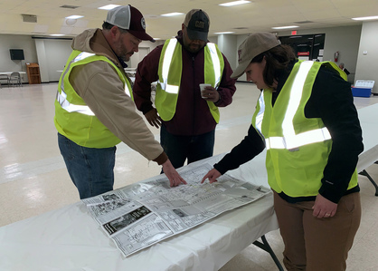 Calhoun County agents consider safe routes to rescue livestock. Photo by MSU Extension Service.