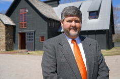 Scott Cagle stands in front of the iconic stables at Lone Oaks Farm.