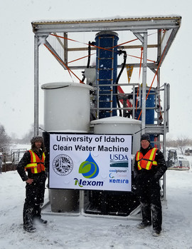 University of Idaho mechanical engineer Martin Baker, left, and environmental chemist Greg Moller ready the U of I Clean Water Machine for testing.