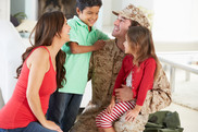 Family Greeting Military Father Home On Leave. USDA NIFA Fresh From the FIeld.