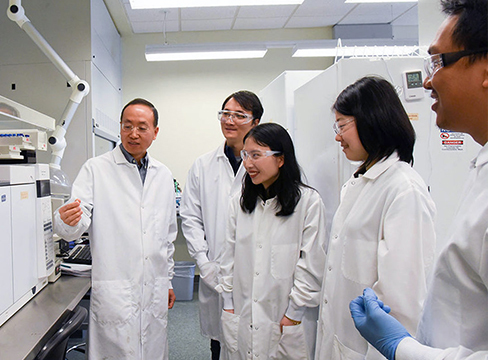 WSU associate professor Hanwu Lei, left, and his team. Photo courtesy of WSU.