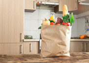 Paper bag full of healthy food on a wooden table in the kitchen close up with copy space. Getty Images. USDA NIFA Fresh From the Field. NIFA Impacts.