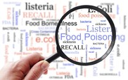 Food poisoning related terms, salmonella, e coli etc, in a word cloud with magnifying glass. Getty Image. USDA NIFA Impacts.