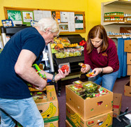 Photo courtesy of University of Minnesota. Lorelei Schelhaas with Larry Giff, unloading fresh food.
