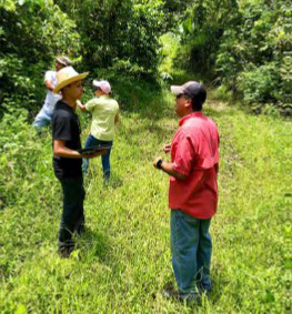 Resource Conservationist, Anibal Velazquez, works with PR farmer to identify conservation needs.