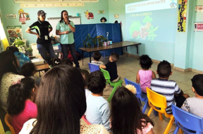 Agro. Figueroa and Agro. Reyes teach Juana Diaz youth about plants.