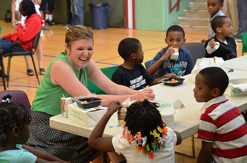 USDA Center for Faith-Based and Neighborhood Partnerships Director Norah Deluhery eats lunch with kids