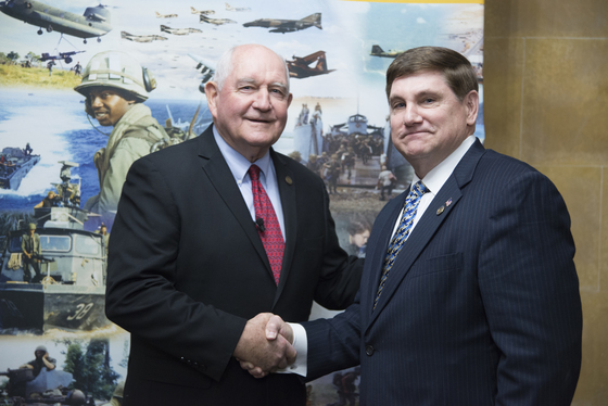 Secretary Perdue receives a Vietnam Veteran lapel pin from Larry Brom of the Vietnam War Commemoration