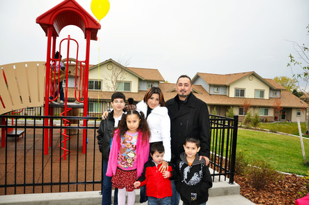 Family in front of apartment complex