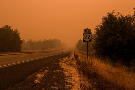 Smokey skies with a fire glow above Highway 22 during Oregon's 2020 wildfires