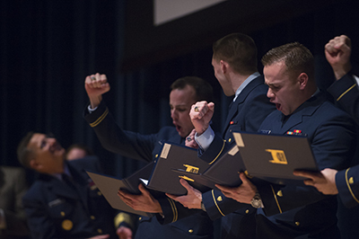 NEW LONDON, Conn. -- Members of the U.S. Coast Guard Academy Class of 2016 receive their first assignments during billet night March 3, 2016.