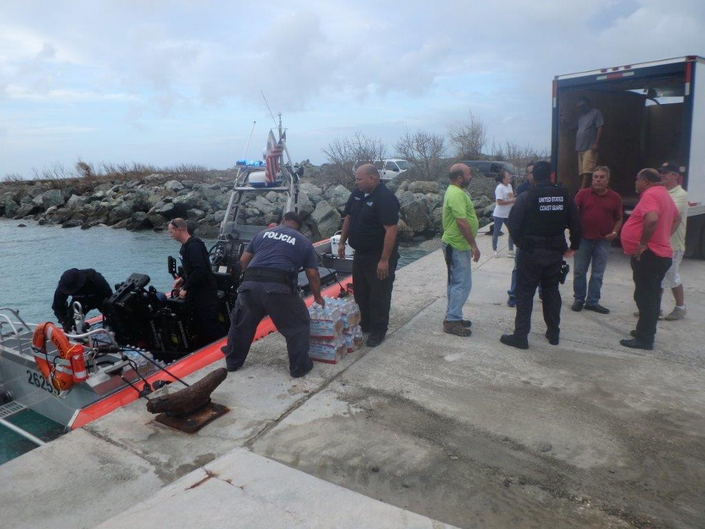 The crew of the Coast Guard Cutter Donald Horsley delivers food and water from FEMA to Vieques, Puerto Rico, Sept. 22, 2017. The crew offloaded 750 liters of bottled water and 1,440 meals. (U.S. Coast Guard photo courtesy of Coast Guard Cutter Donald Horsley)
