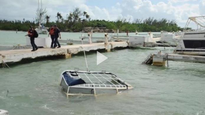 Hurricane Maria response team assesses damage vessels in Isleta Marina, Puerto Rico