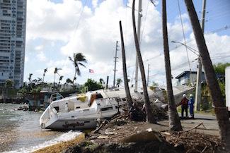 Hurricane Maria salvage crews remove wrecked boat from road in Fajardo, Puerto Rico